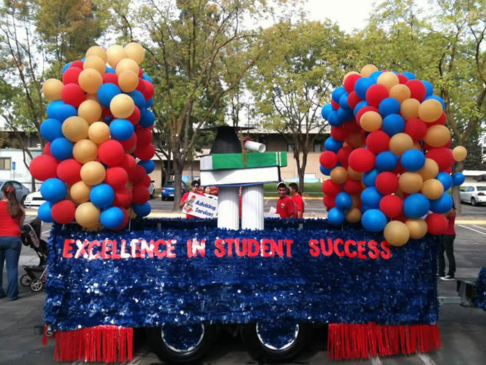 Student Affairs Centennial Float at Homecoming Parade
