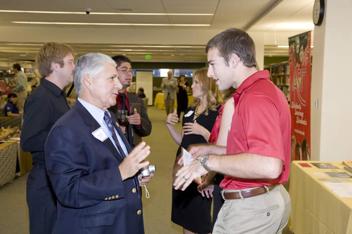 Paul DeRuosi talking to past ASI president (Wahlberg)