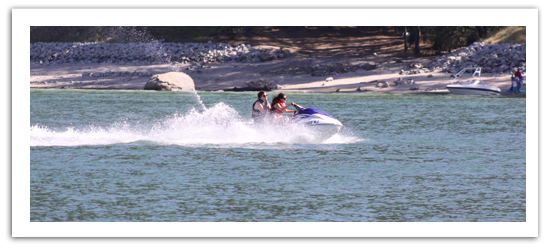 women riding a jetski on the lake