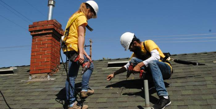 ASB members installing roofing