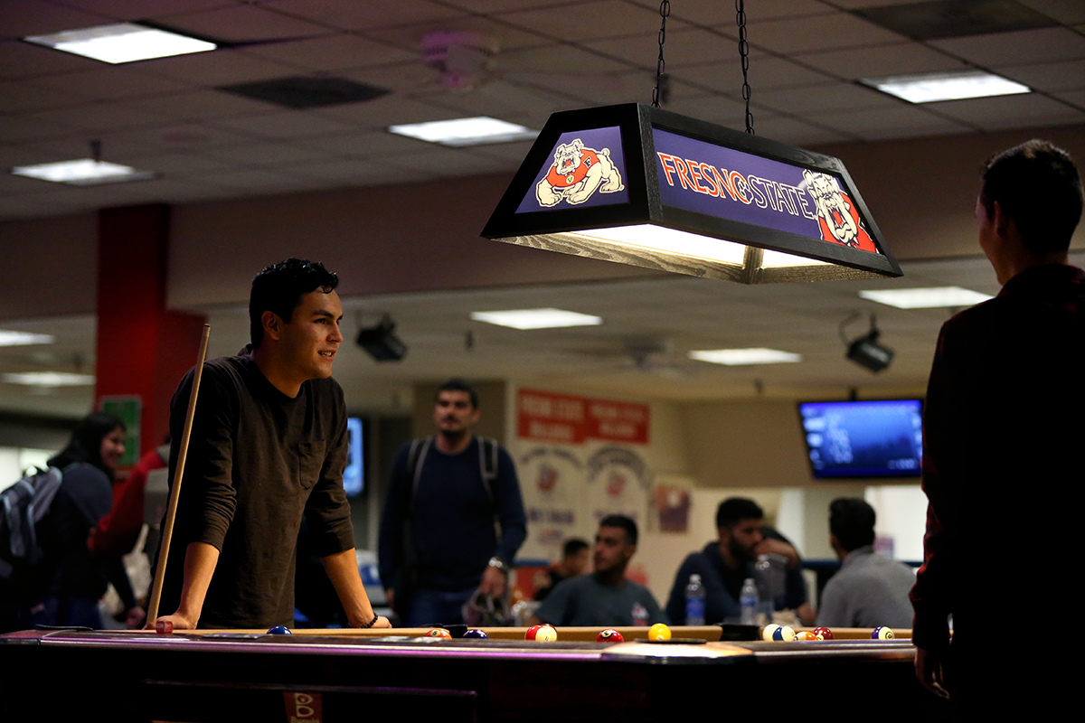 Students playing pool at the newly upgraded Bulldog Bowl