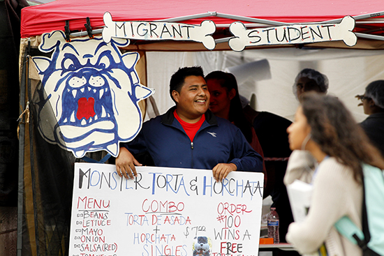 Migrant Student Club food booth at Vintage Days